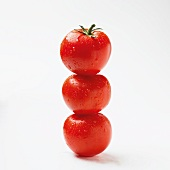 Three tomatoes, stacked