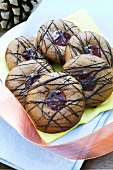 Soft honey biscuits with raspberry jam and chocolate glaze