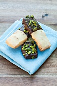 Crunchy bars with chocolate coating and pistachios