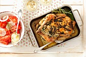 Pollo alla erbe (chicken roasted with herbs) with a tomato and onion salad