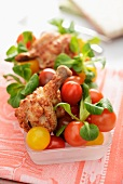 Chicken legs with cherry tomatoes and lamb's lettuce