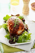 Rolled roast turkey with salad