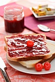 Sliced white bread with cherry jam