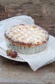 Gooseberry cake with a meringue top and icing sugar
