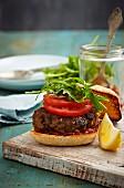 Lamb burger with tomatoes and rocket (Morocco)