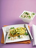 Fish baked in foil with courgettes and coconut rice