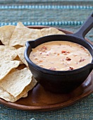 Chili Con Queso in a Cast Iron Pot with Tortilla Chips