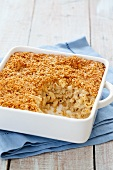 Southern Style Mac and Cheese in a Baking Dish with a Scoop Removed