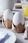 Egg cups of folded newspaper