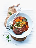 Osso buco (stewed cross-cut veal shin) with carrots