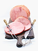 Rolled ham, partly sliced