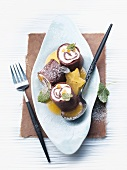 Chocolate pancakes with apricot & quark filling and star fruit