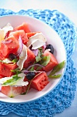 Watermelon salad with goat's cheese, red onions, olives and rocket