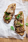 Open sandwich with grilled oyster mushrooms, thyme and oregano