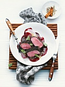 Saddle of lamb fillet with vanilla-cinnamon crust on red beet carpaccio