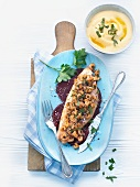 Pike-perch with crabs on red beets