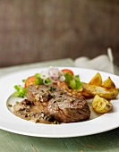 Pepper rump steak with morel sauce