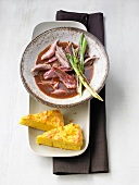 Pork in barbecue sauce with spicy polenta cake