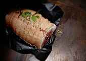 Rolled roast, tied, on wrapping paper ready for stewing