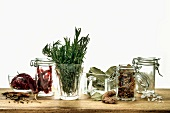 Sill life with assorted herbs and spices in glass containters