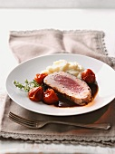 Saddle of venison with tomatoes and mashed potatoes
