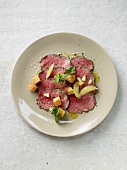 Seared beef carpaccio with croutons