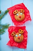 Two decorative gingerbread cookies look like a reindeers