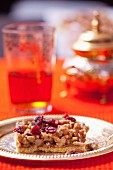 Shortbread tart with nuts, dried cranberries and honey crunch