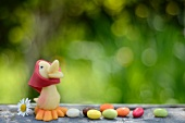 Marzipan chick and jelly beans on a garden table