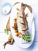 Stuffed salmon trout with lentils