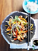 Thinly sliced turkey with Asian vegetables and rice