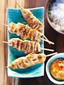 Satay skewers with chili sauce and rice