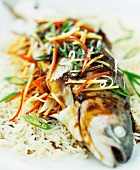 Trout with vegetables on a bed of rice
