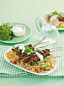 Tandoori skewers on vegetable rice