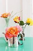 Roses in various vases