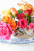 Colourful roses in a small jug