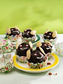 May bug muffins with chocolate icing and almonds