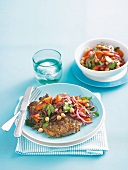 Lamb chops with warm carrot and chickpea salad