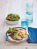 Steak Diane with chips and a side salad