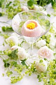 Wagashi in the shape of a camomile flower in a cocktail glass