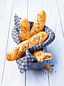 Beer bread baguette rolls with caraway seeds in a bread basket