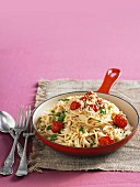 Spaghetti with salmon, roasted tomatoes and breadcrumbs