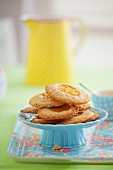Wholegrain biscuits with peach jam on a cake stand