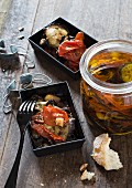 Tomatoes and aubergines preserved in oil