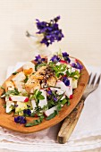 Radish salad with chicken, croutons and violets