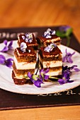 Cake cubes with candied violets