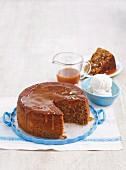 Raisin cake with caramel sauce and vanilla ice cream