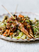 Grilled turkey skewers on a bed of lentil and vegetable salad