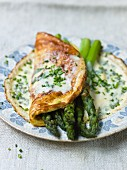 Asparagus omelette with cheese sauce