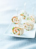 Tortilla rolls filled with smoked salmon, cream cheese and dill